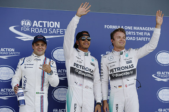 Silverstone, Northamptonshire, England. Saturday 04 July 2015. Top three qualifiers, Lewis Hamilton, Mercedes AMG., Nico Rosberg, Mercedes AMG, and Felipe Massa, Williams F1, in Parc Ferme. World Copyright: Glenn Dunbar/LAT Photographic. ref: Digital Image _89P2708