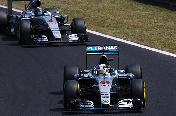 Hungaroring, Budapest, Hungary. Saturday 25 July 2015. Lewis Hamilton, Mercedes F1 W06 Hybrid, leads Nico Rosberg, Mercedes F1 W06 Hybrid. World Copyright: Charles Coates/LAT Photographic. ref: Digital Image _J5R6035