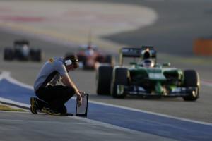 A Pirelli technican takes the temperature in the pit lane