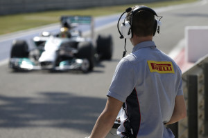 A Pirelli technician watches the track action
